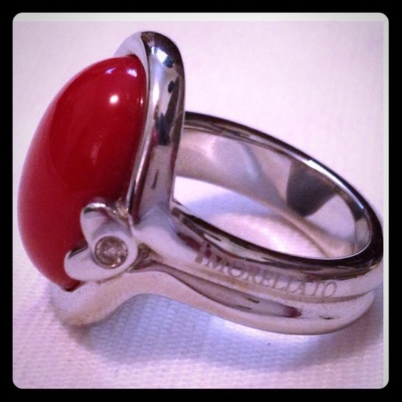 ❤️ New Ring Red Stone  Sz 8 Very Pretty red stone ring, unknown stone might be man made. Heart in side with crystal set in center. Marked in side by maker. Size 8. By Italian designer Morelatto.  Stainless steel. Fair offers will be considered. Morellato Jewelry Rings