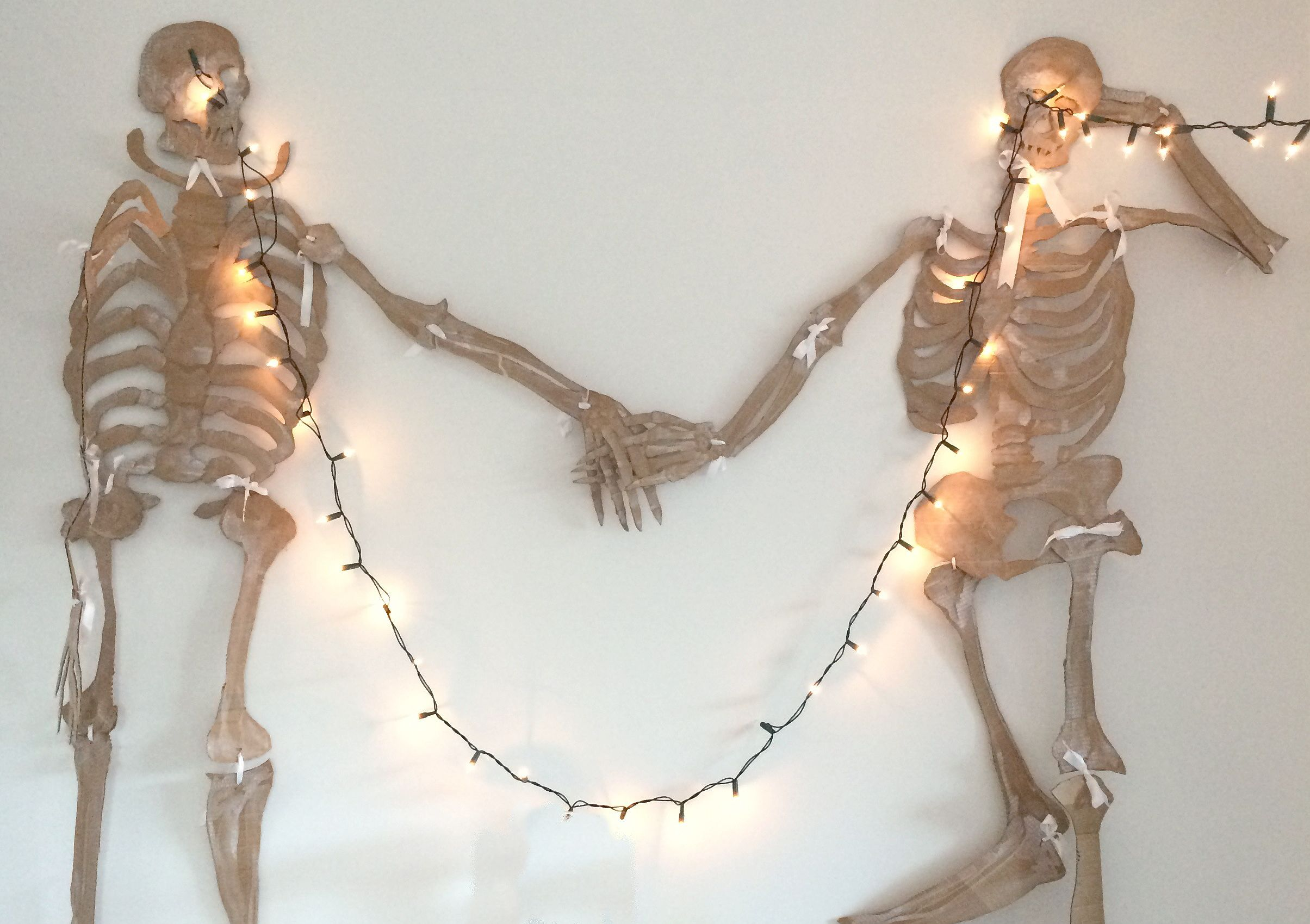 Home Tour: Alexa's Skeleton Party. Home-made Halloween Skeletons. Cut outs of cardboard tied together with ribbon at the joints. A brilliant DIY for the kids! #hometour #diy #halloween #skeletons #handmade