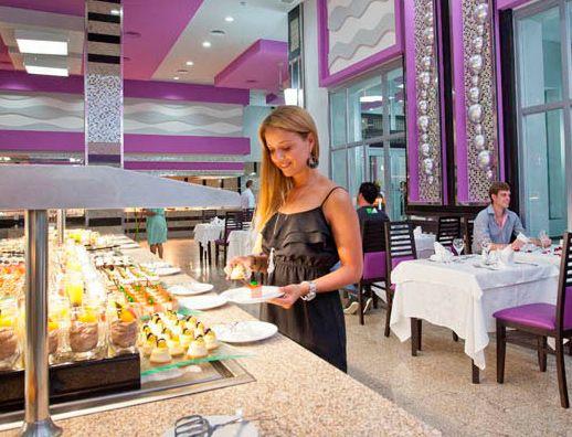 Vista 2 comedor buffet cortes a hoteles riu hotel for Proposito del comedor buffet