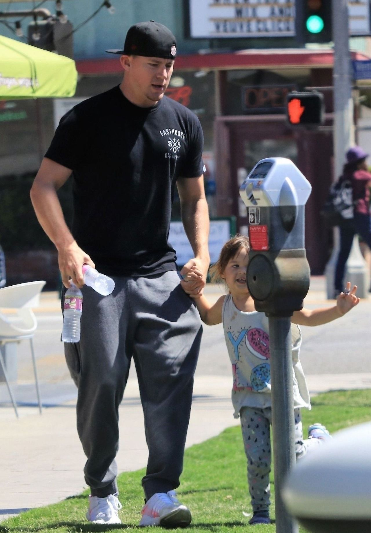 749e06f0 Channing Tatum looking comfy, wearing a Black cap T-shirt Grey Trousers and  White Shoes