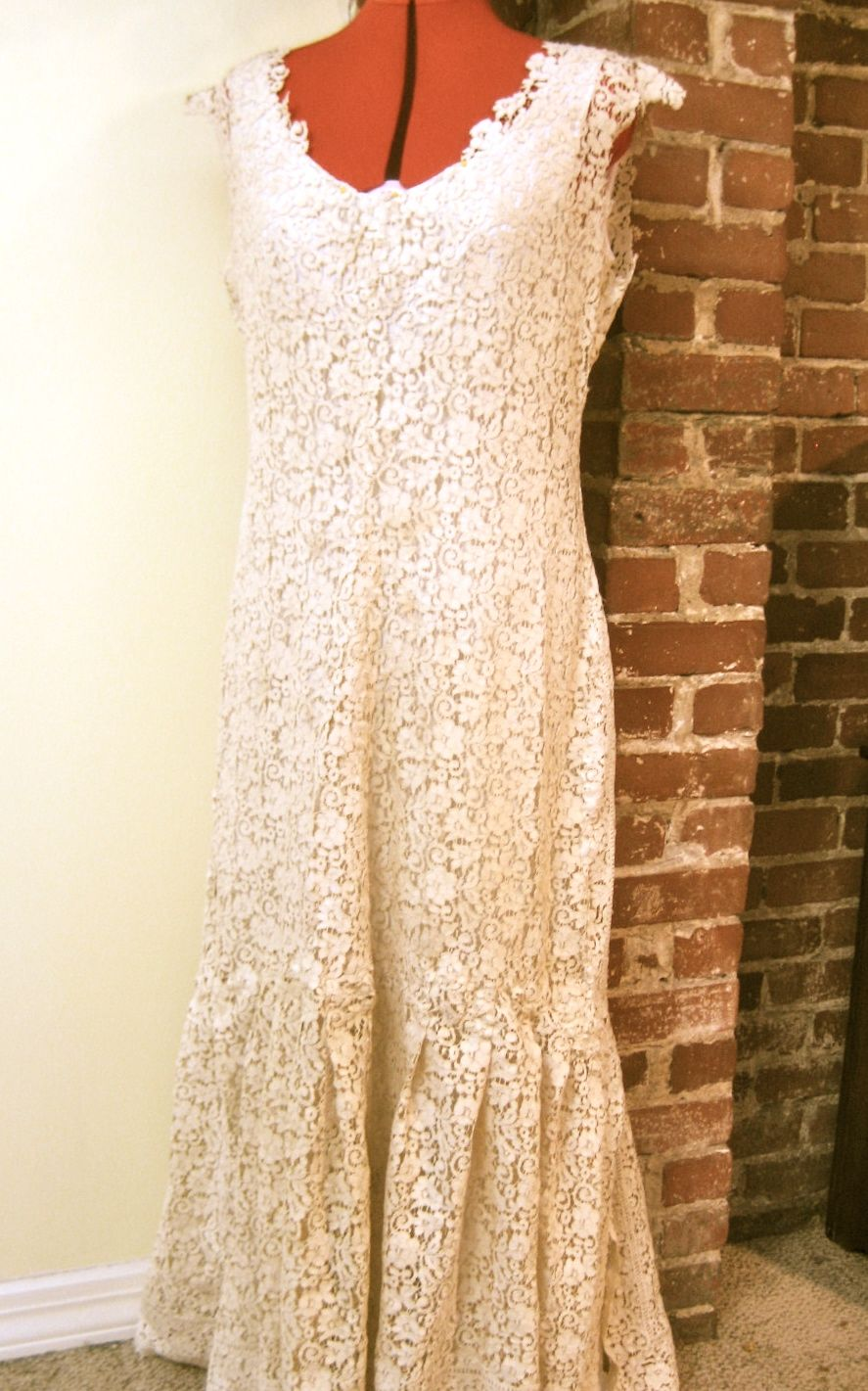 This upcycled wedding dress is made from an antique lace table