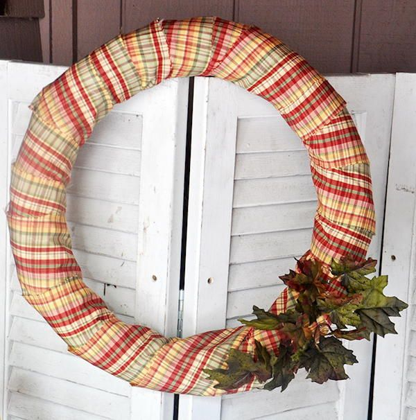 DIY Fall Wreath From a Pool Noodle #poolnoodlewreath You can reuse something you might throw away with this DIY Fall Wreath From a Pool Noodle craft. This DIY fall wreath is so easy, and you can use up some scrap fabric as well. #poolnoodlewreath