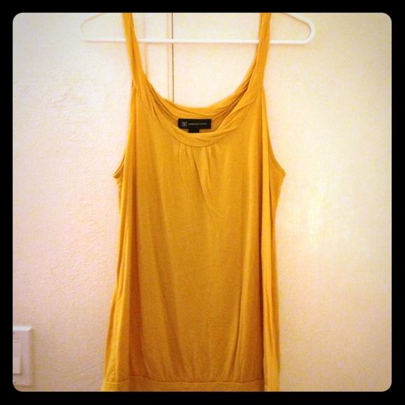 INC International Concepts large tank top yellow INC International Concepts large yellow tank top, twisted straps.                                         Make me an offer! INC International Concepts Tops Tank Tops