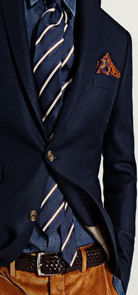 Orange Corduroy pants (matching pocket square to the pants brilliant) and blue tonal layered tops. inspired