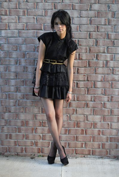 The strong shoulder and feminine skirt are great complements.