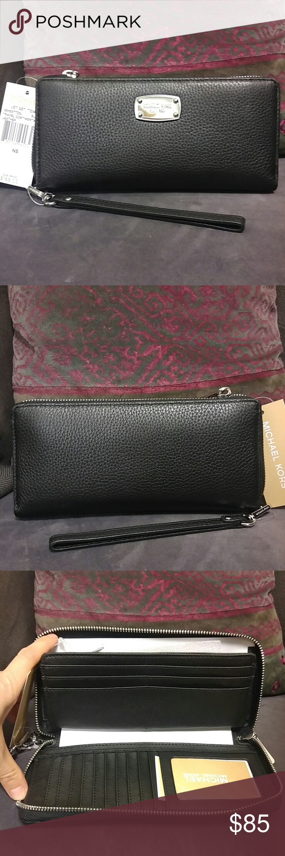 Michael Kors Wallet NWT MK black travel continental wallet with silver hardware. Inside has 16 card slots, space for a visible ID, pockets, space for cash, and a zip compartment for change. No holds or trades. Michael Kors Bags Wallets