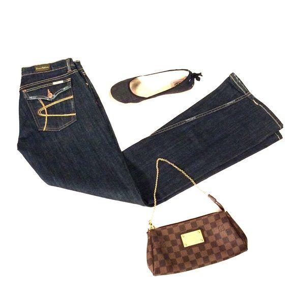 Dark blue denim David Kahn bootcut jeans Dark blue denim David Kahn bootcut jeans fabric 98% cotton 2%  polyurethane inseam 31 inch inseam made in USA David Kahn Jeans Boot Cut
