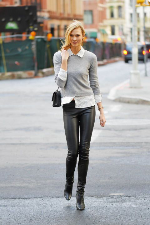 The leggy supermodel pairs a preppy button-down shirt and cashmere knit with her Tamara Mellon legging boots.