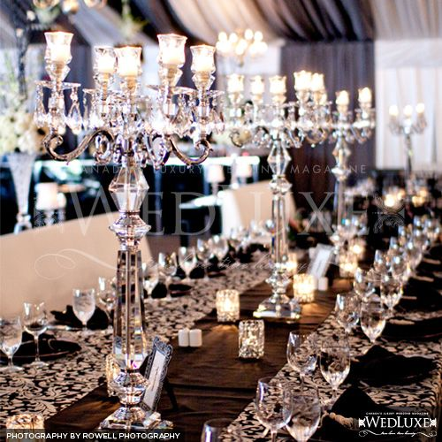 Black and white candelabras for a wedding reception for Glass tables for wedding reception