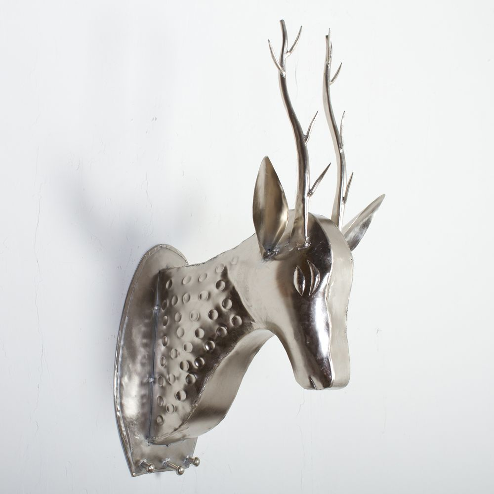 This decorative deer figurine provides an eye-catching addition to ...