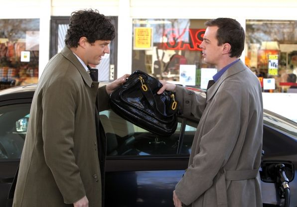 Who's Purse? (season 9, episode 17) :  Top-secret clearance from a Naval research laboratory is jeopardized when the murder of a Chief Petty Officer is connected to an international arms dealer. Meanwhile, Probationary Agent Ned Dorneget (Matt Jones, left) tries to butter up Gibbs in hopes of joining the team, on NCIS. Also picured: Sean Murray, right as NCIS Special Agent Timothy McGee Photo: Monty Brinton/CBS ©2012 CBS Broadcasting Inc. All Rights Reserved.