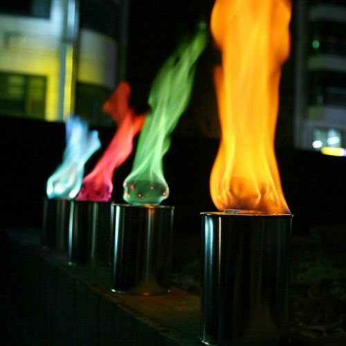 Colored flame lighting by more than light torch light outdoor colored flame tiki torches add a festive air to your backyard patio or porch whether at home or at the lake house workwithnaturefo