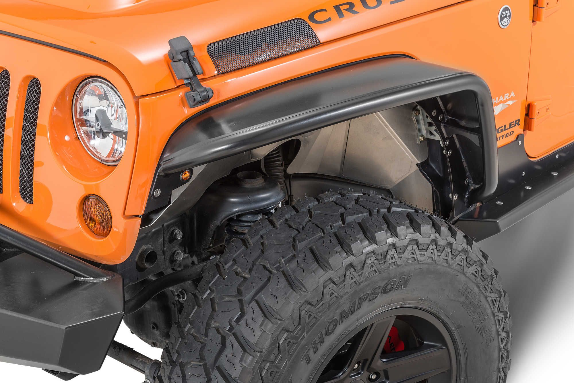 5b5924beb35a1 The Jeep JK s thin sheet metal fenders and stock plastic flares are among  the most vulnerable body components when traversing the trail. The Poison  Spyder ...