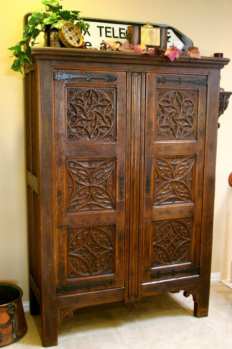 unusual solid wood media cabinet. Rare Gothic Press Cupboard of solid English Oak with six ornately carved  Celtic symbols
