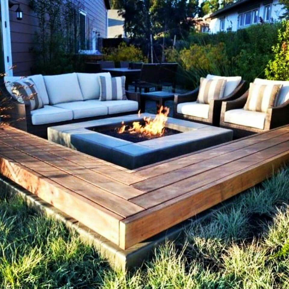 Fire pit with built in retainer wall e bench seat