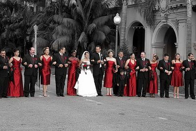 beautiful wedding day pic of red and black wedding colors against a black and white background