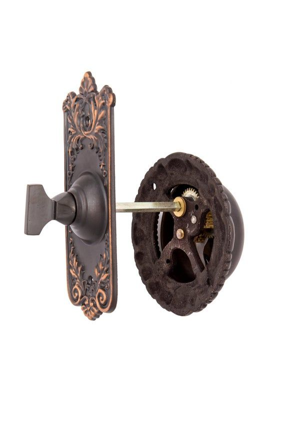 Lorraine french country style doorbell. The original Lorraine pattern dates back to the early 1900's. This bell has a bright, crisp ring. The turn is mounted on the outside of the door and passes through to the bell on the inside of the door by a spindle. The spindle we send measures 3 inches, but we can send a longer spindle if needed. Let us know through messenger. The doorbell measures 3 3/4 inches in diameter. The doorbell turn measures 4 1/2 inches by 2 1/4 inches. We will include screws wi