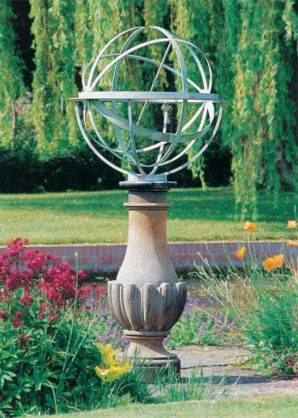 Brass Armillary Sphere On Elegant Plinth In Classic Garden