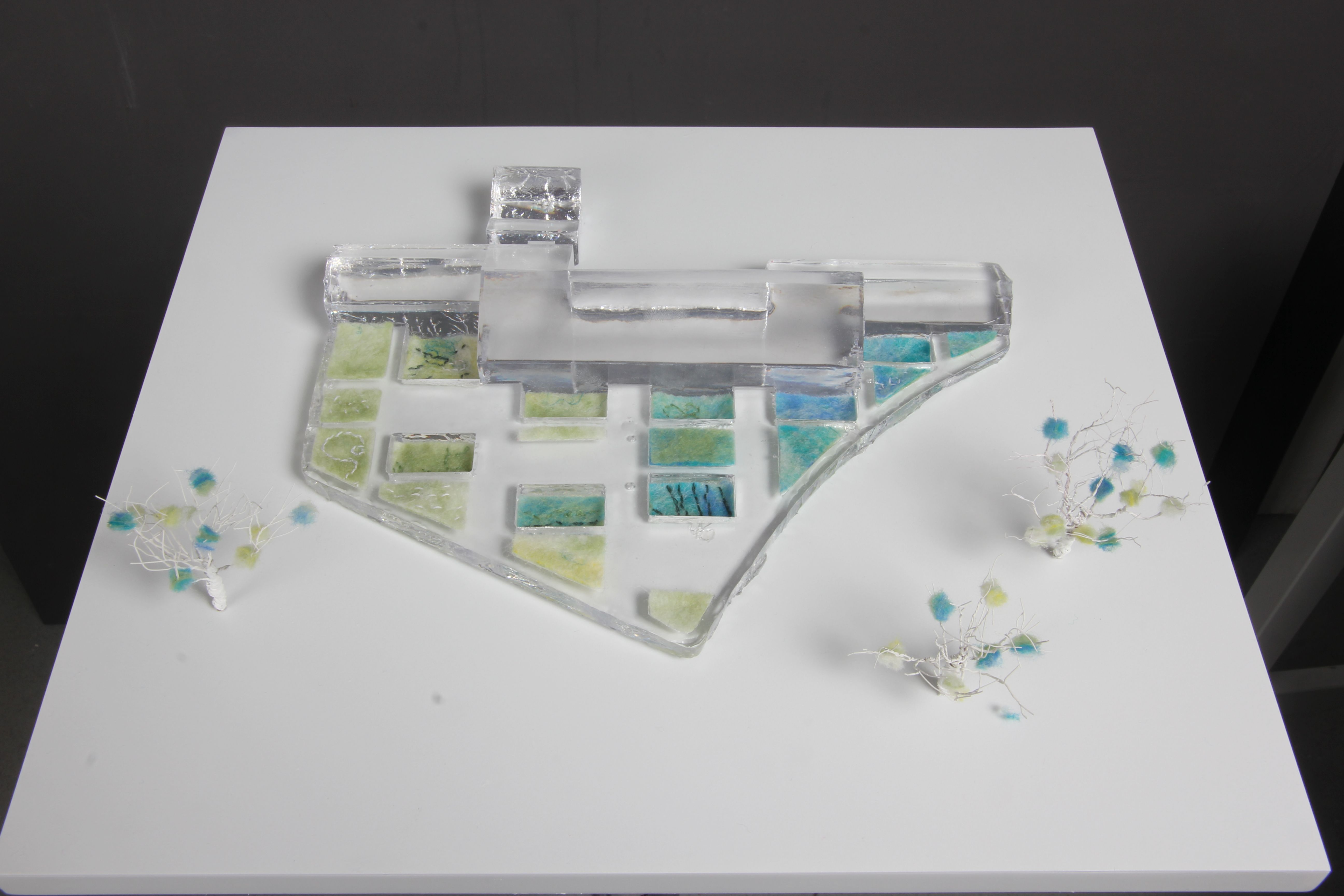 Final Piece - Clear resin building with handmade felt pieces to represent the plant life.