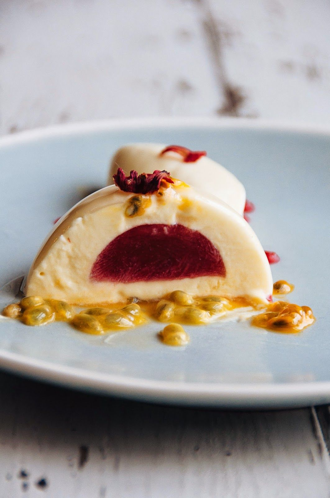 passion fruit, white chocolate and hibiscus plated dessert.