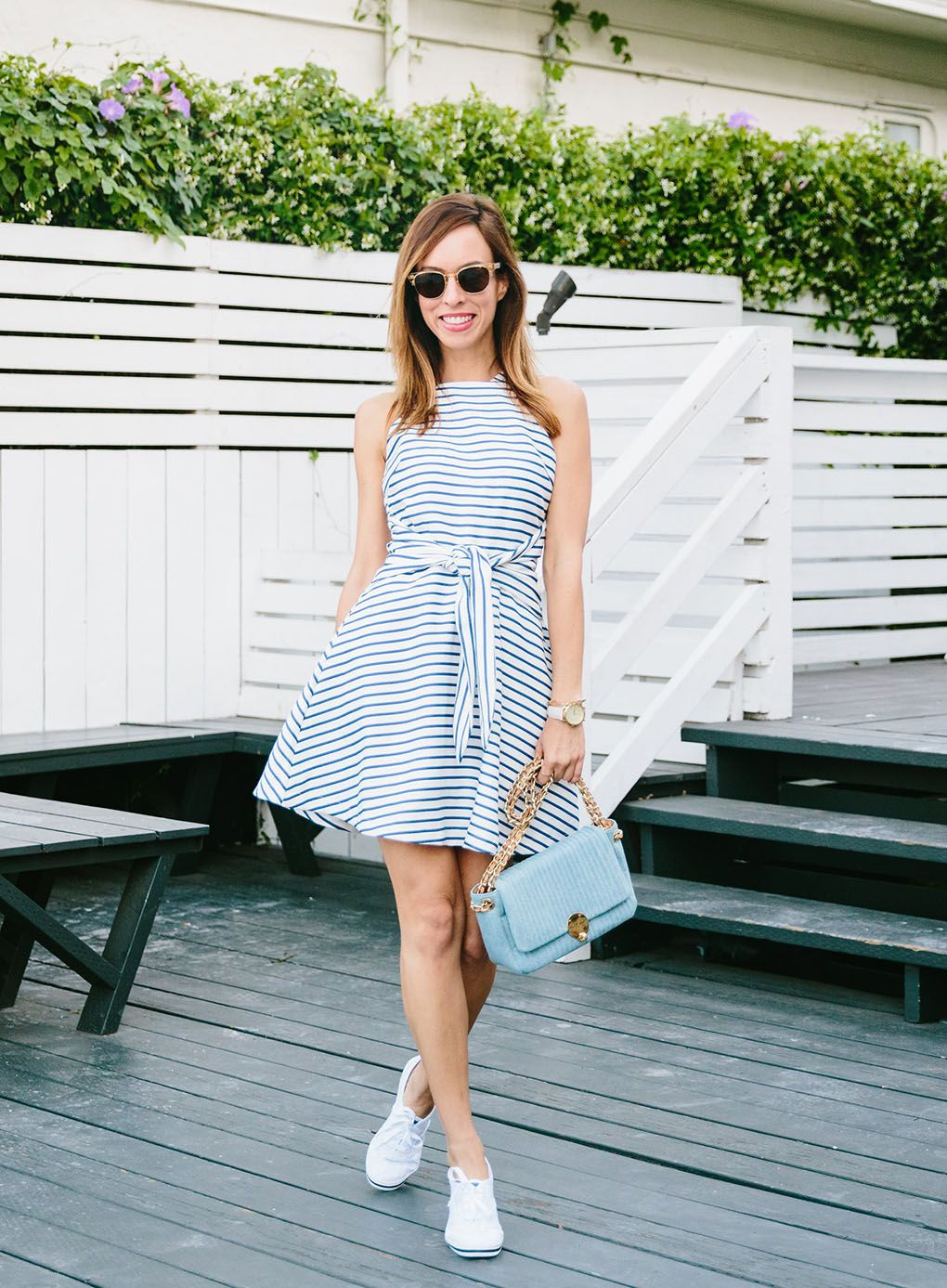 3c59899a7a2 Sydne Style wears Joa tie front striped dress with sneakers for summer style
