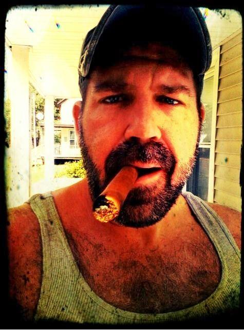 Iron shiek smoking a cigar