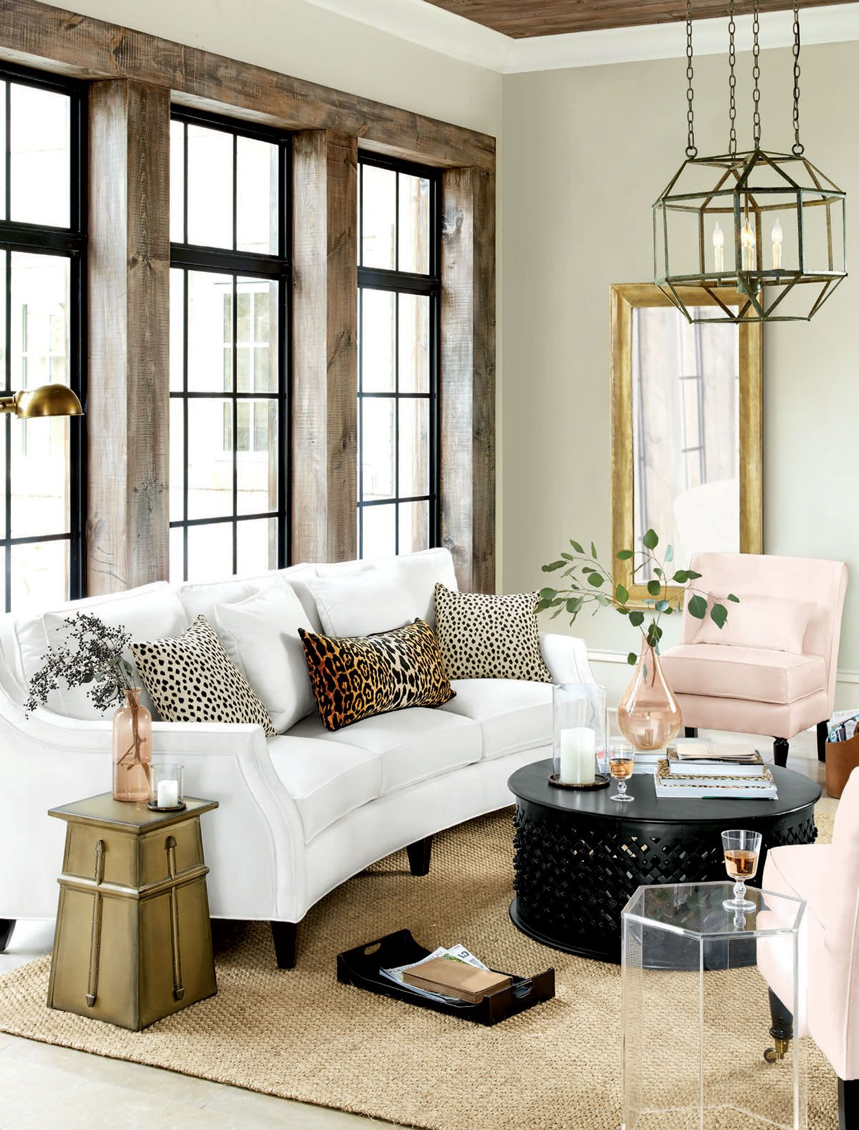 A Few Animal Print Throw Pillows Bring Playful Modern Edge To This Living Room