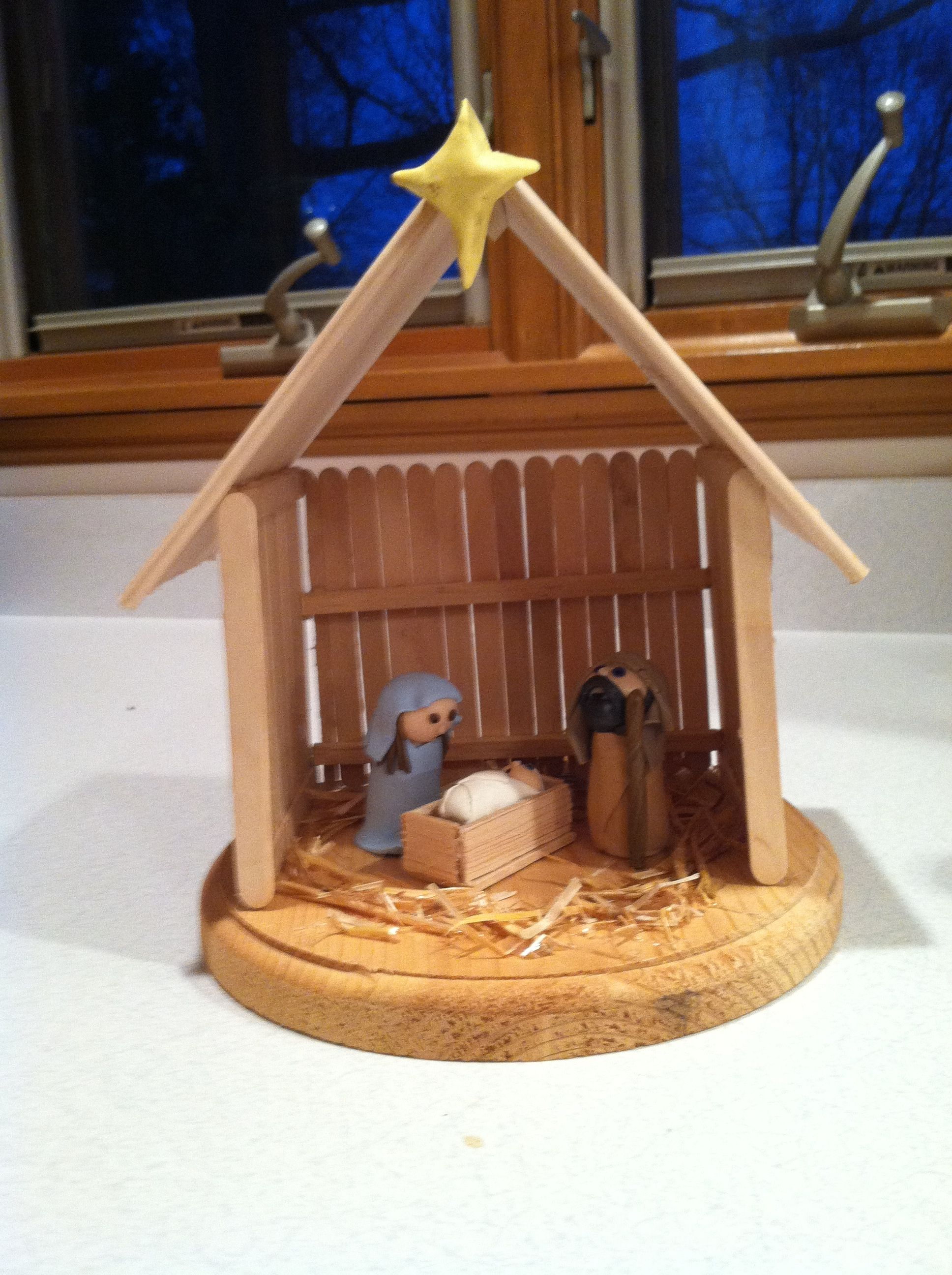 Homemade Nativity from clay and Popsicle sticks Credit