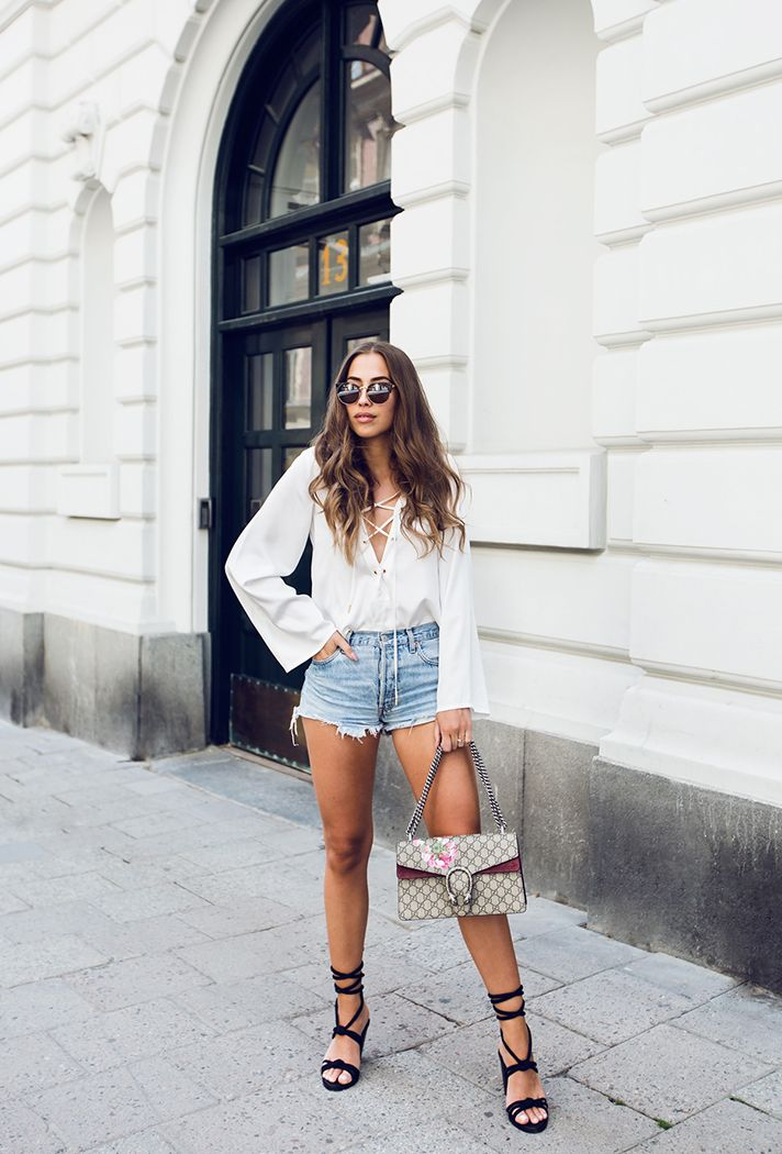 Browse the best denim short outfit inspiration and products at @Stylecaster | blogger 'Kenza Zouiten' in white peasant blouse, cutoff shorts, black sandals