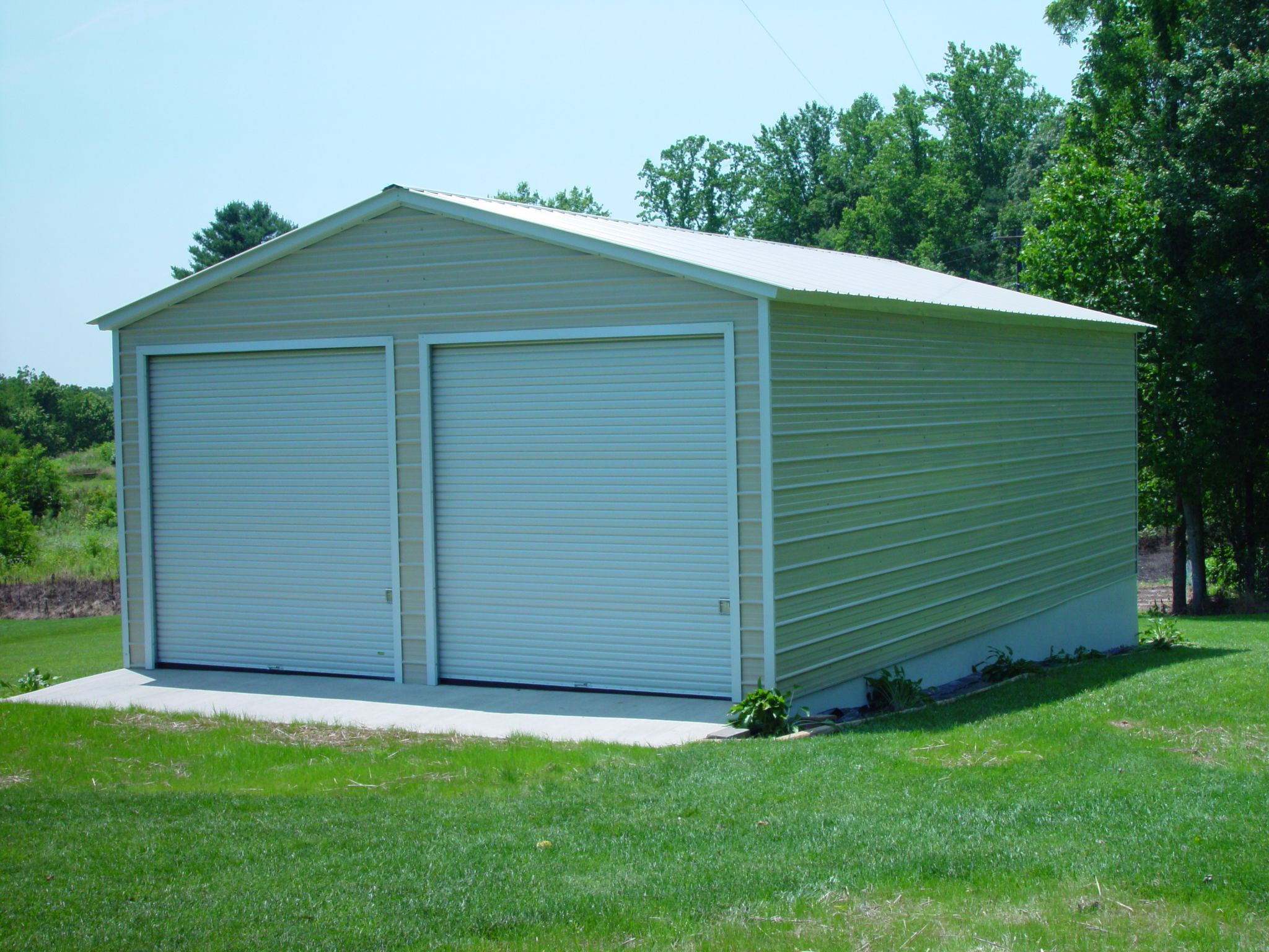Metal garages like this on are inexpensive solutions to
