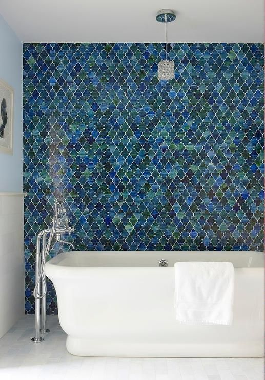 Fantastic Bathroom Boasts An Accent Wall Clad In Emerald Green And Ocean Blue Moroccan Tiles