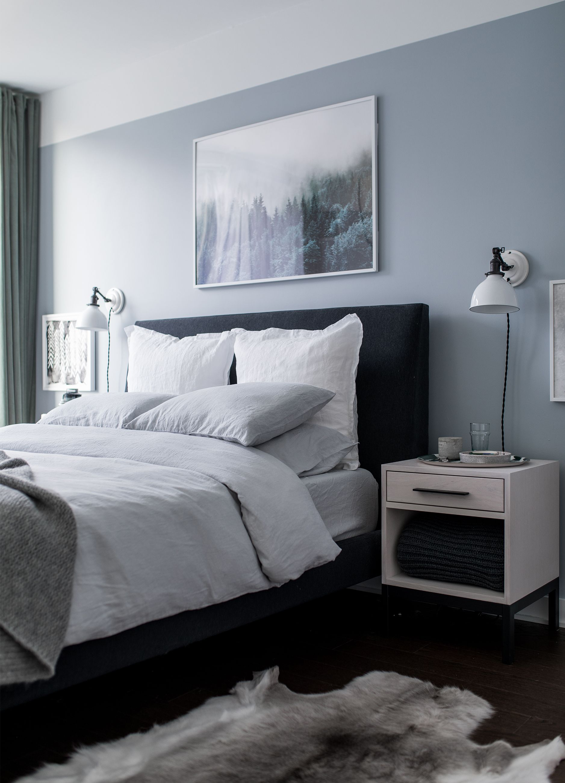 Check out a post I did on morning routine to help me feel less tired during the day, my bedroom makeover helped too here this grey bedroom with soft linen bedding, euro sham pillows, School House Electric white industrial pendent lights paired with green velvet curtains brings calm to the design of the room. Decor is so important in the bedroom, even the reindeer hides are so soft under foot!