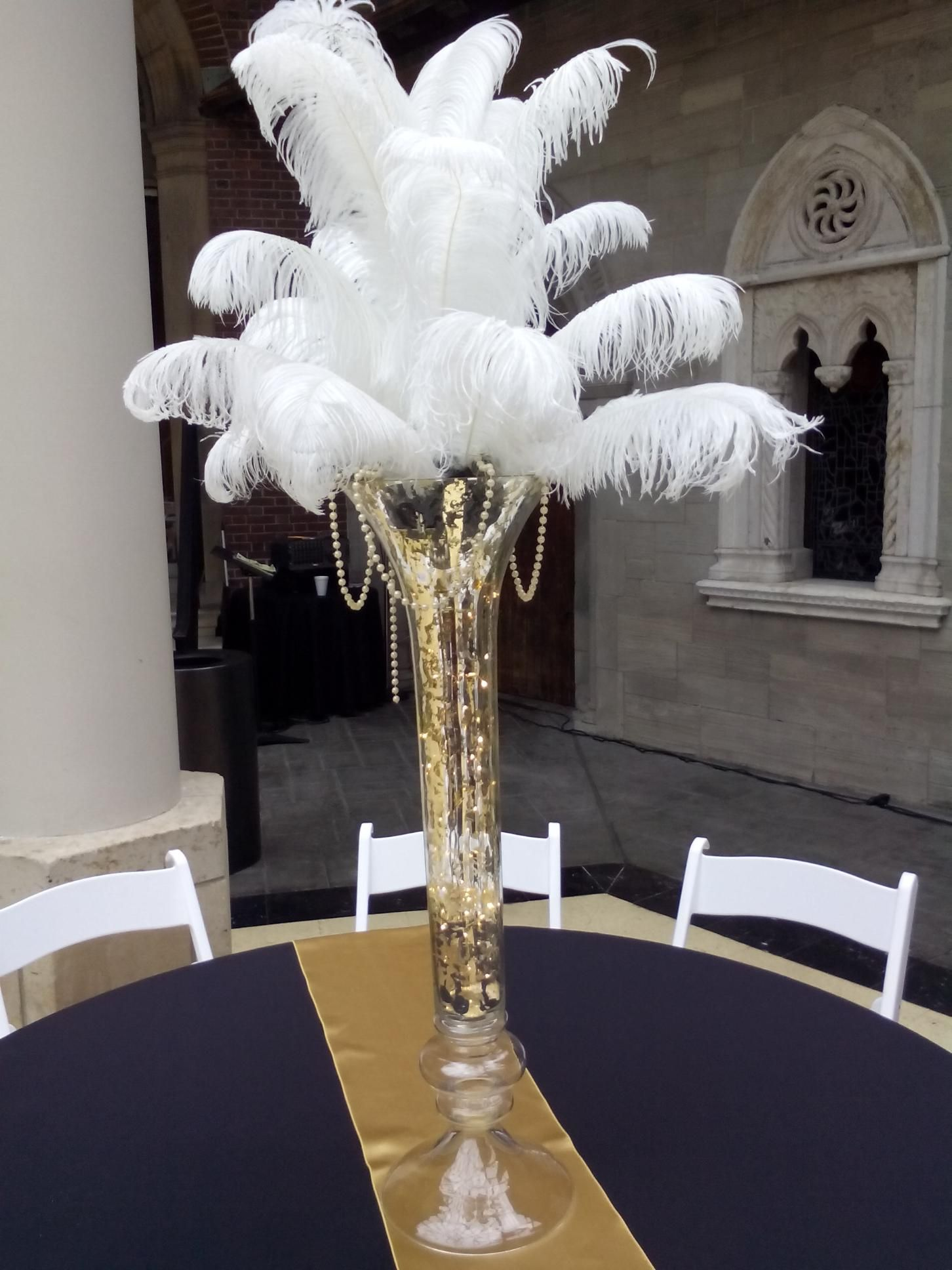 Gatsby weddings. Furst Florist Centerpiece with ostrich feathers #FurstEvents #daytonweddings