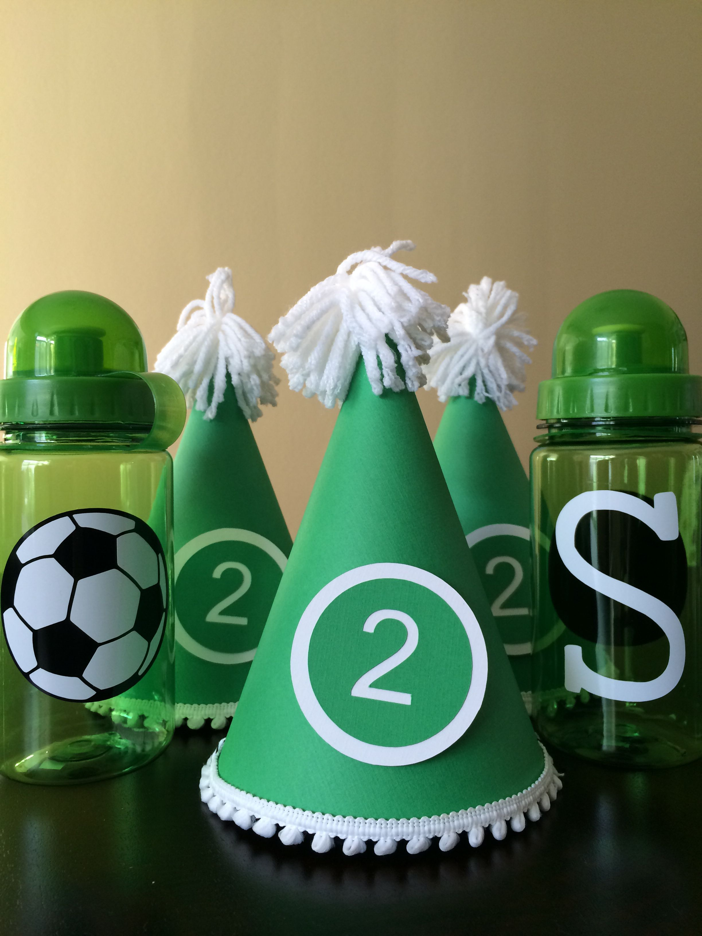 bcfad980e4e5cf The party hats and water bottle favor for the kids for my son's soccer  themed 2nd birthday -- each water bottle was labeled with the child's first  initial.