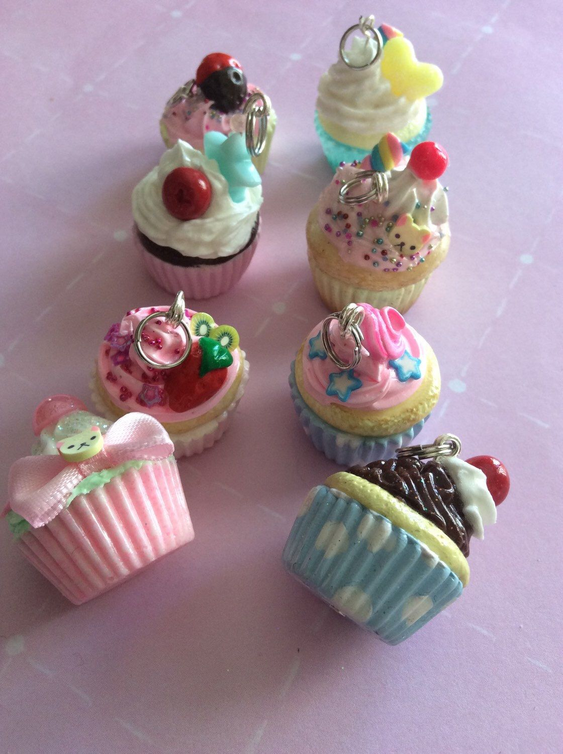 A personal favorite from my Etsy shop https://www.etsy.com/listing/228782093/lot-of-8-polymer-clay-and-resin-cupcake