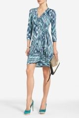 How to wear it: batik print wrap dress with heels and clutch