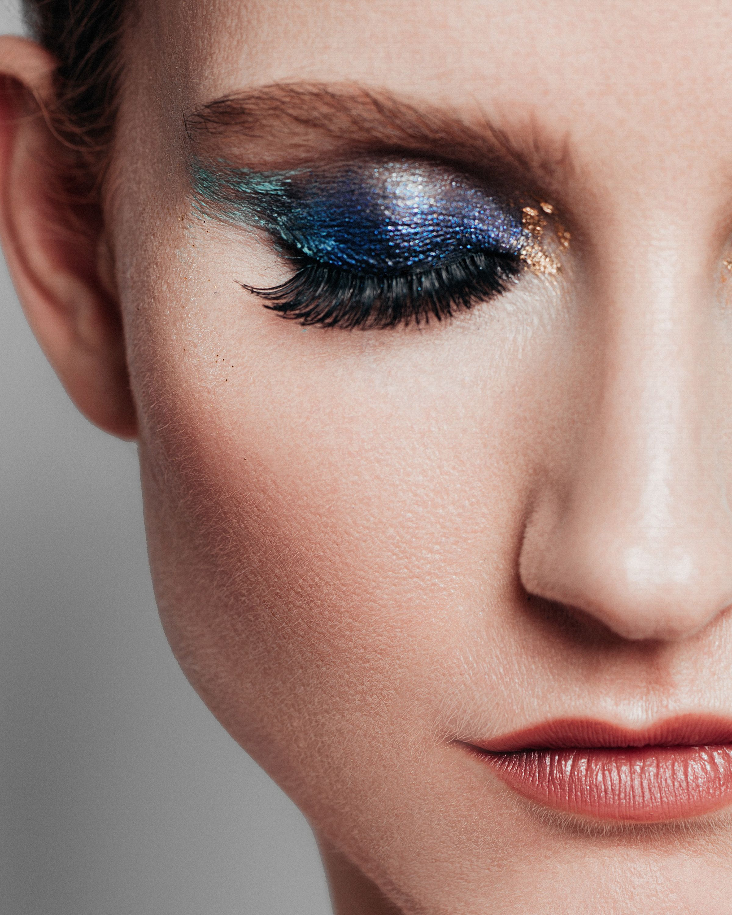 Another angle of a bold makeup look created by Online