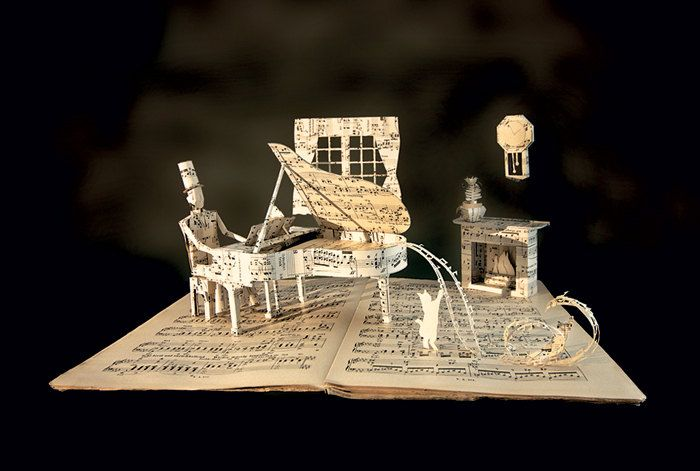 Postcard of the original book sculpture Piano