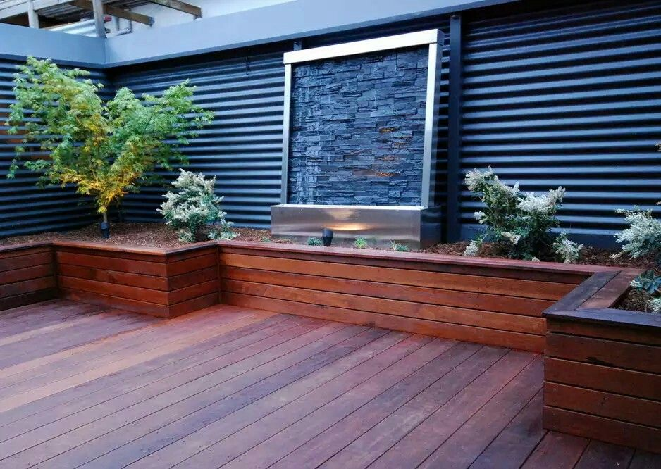 Cover up of retaining wall with timber backyard decking