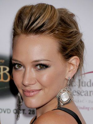 How to Get It: Part dry, straight hair from above the arches of each brow back to the crown to create a mini ponytail. Twist the top of the tail, and push hair forward to create volume, then secure with a large barrette or bobby pins. Gather the rest into a bun and mist with a holding spray