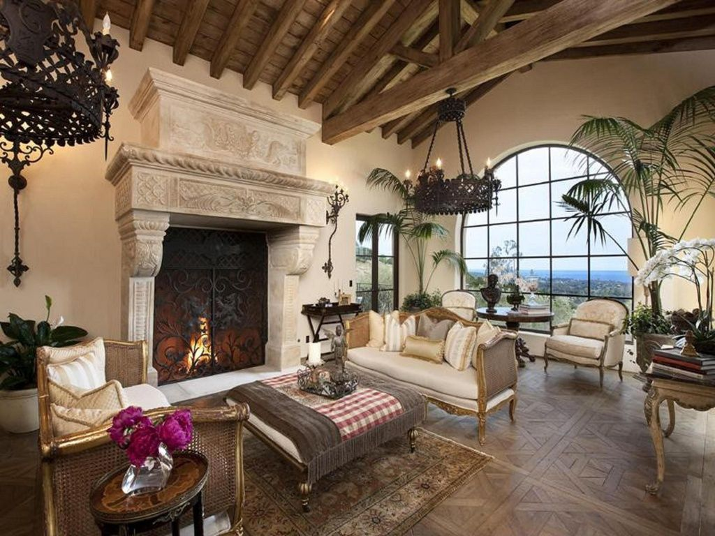 mediterranean living room with cement fireplace, chandelier, metal