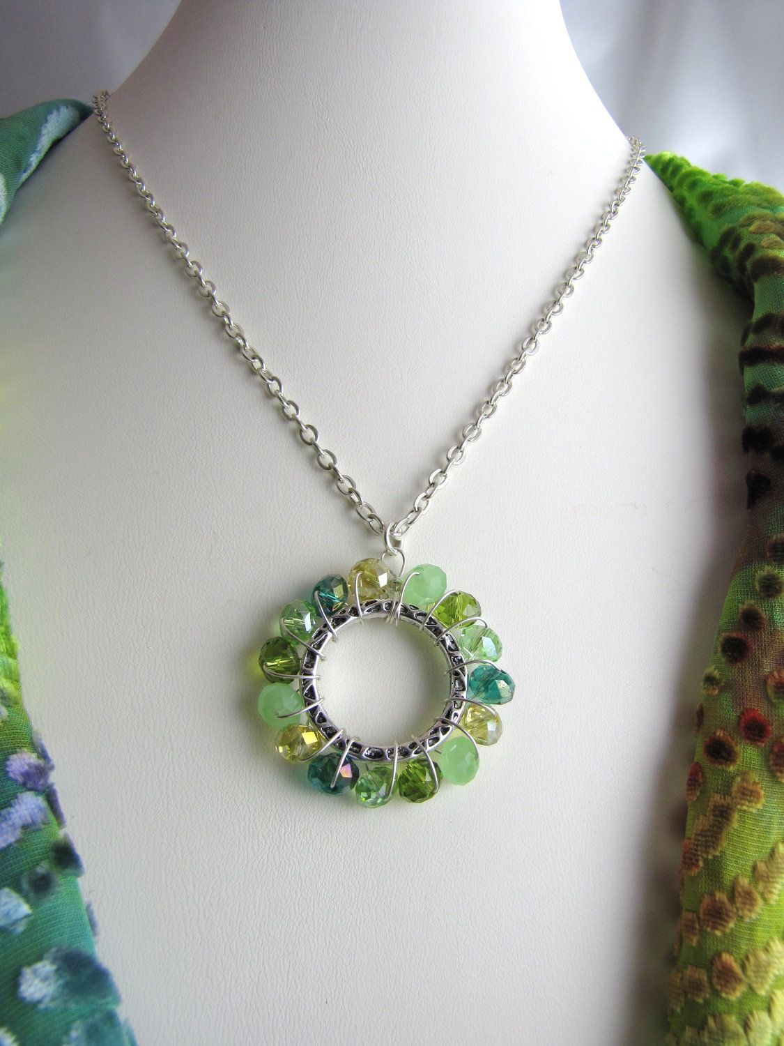 unique wire wrapped crystal ring green color mix necklace.