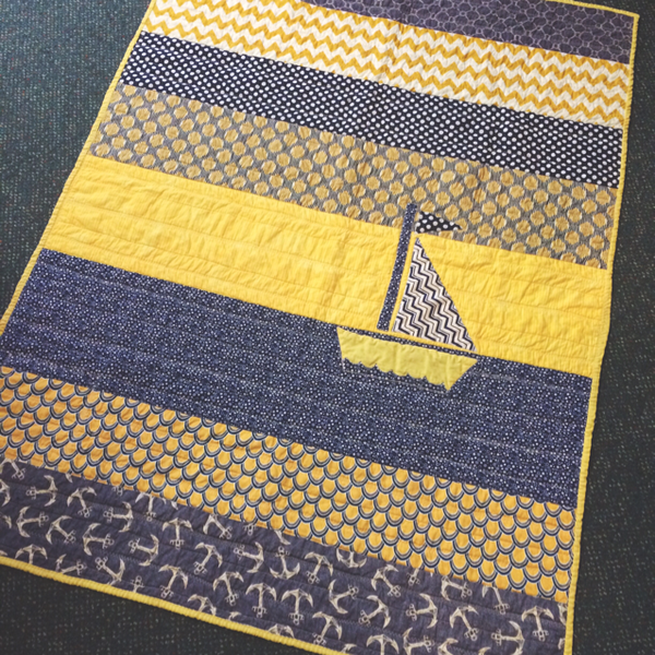 Check out this adorable blue and yellow nautical theme baby blanket created by one of our loving BabyBump Grandmothers to be. #blue #yellow #sail #boat #nautical #patchwork #quilt