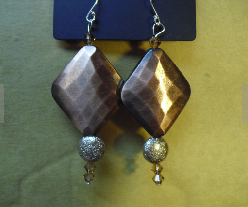 Rustic style sterling silver bronze beaded earrings.  Hand crafted with Swarovski Crystals.  Beautiful addition to any look!