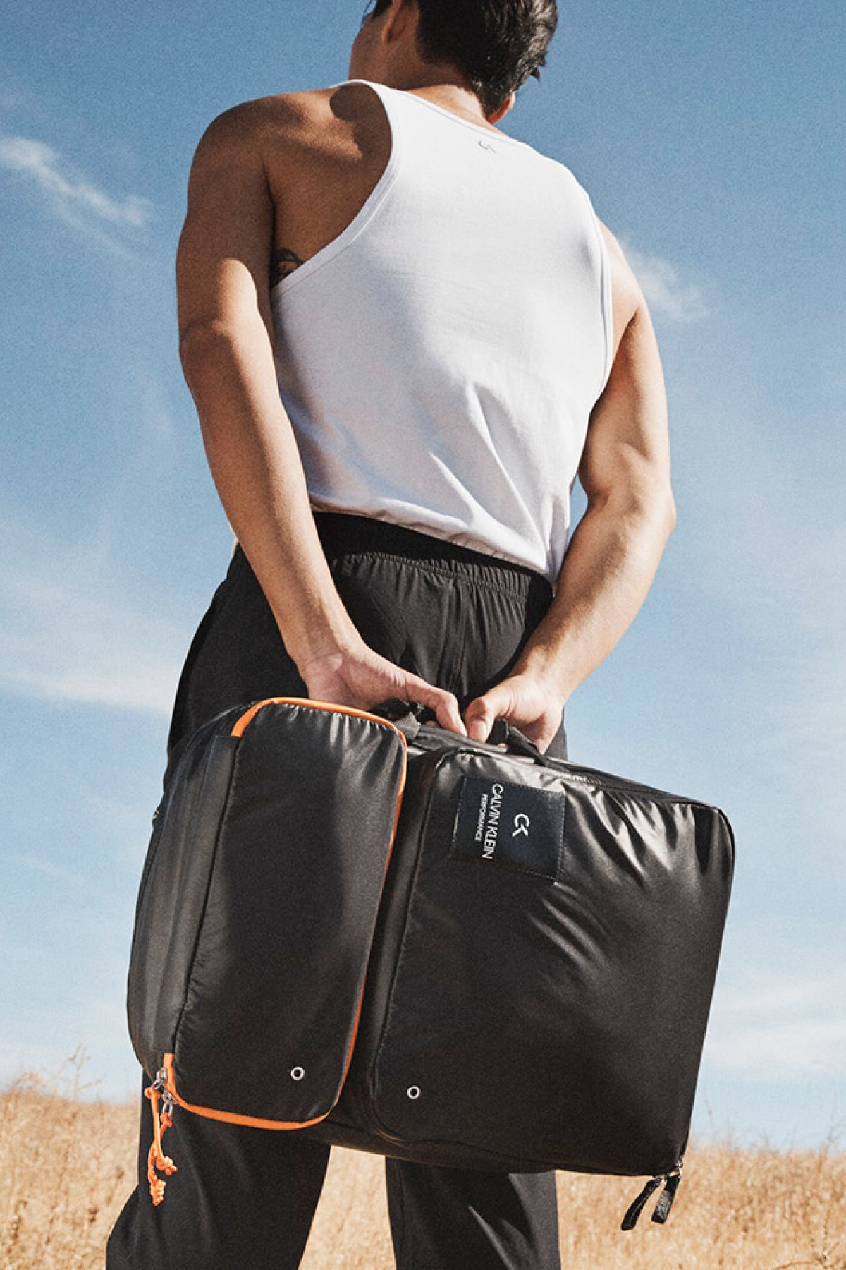 715c8973c4 Our Spring 2019 CALVIN KLEIN PERFORMANCE bomber nylon modular backpack with  adjustable straps is perfect for all of your workout needs.