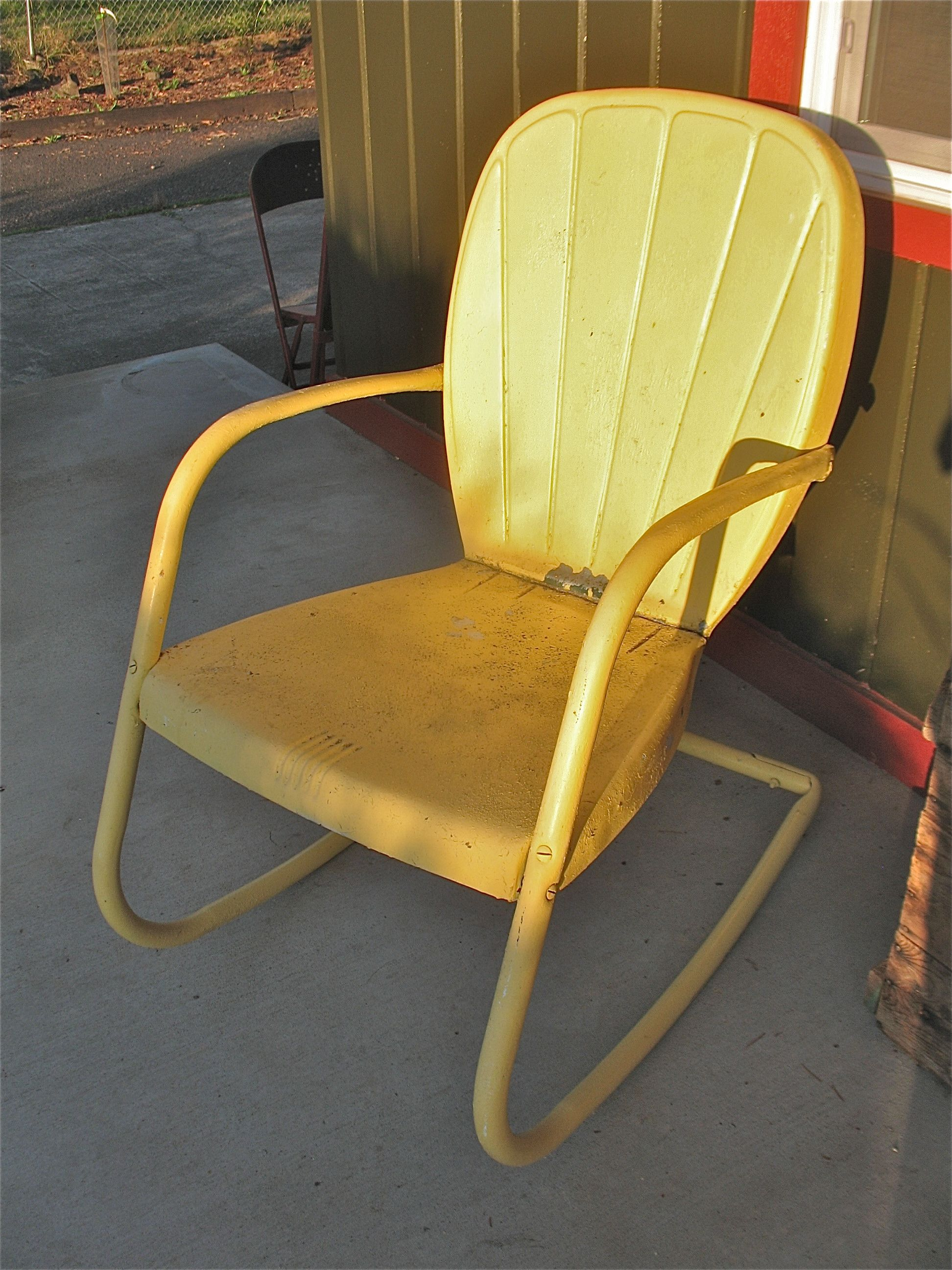 Vintage metal clamshell back motel chairsThis one