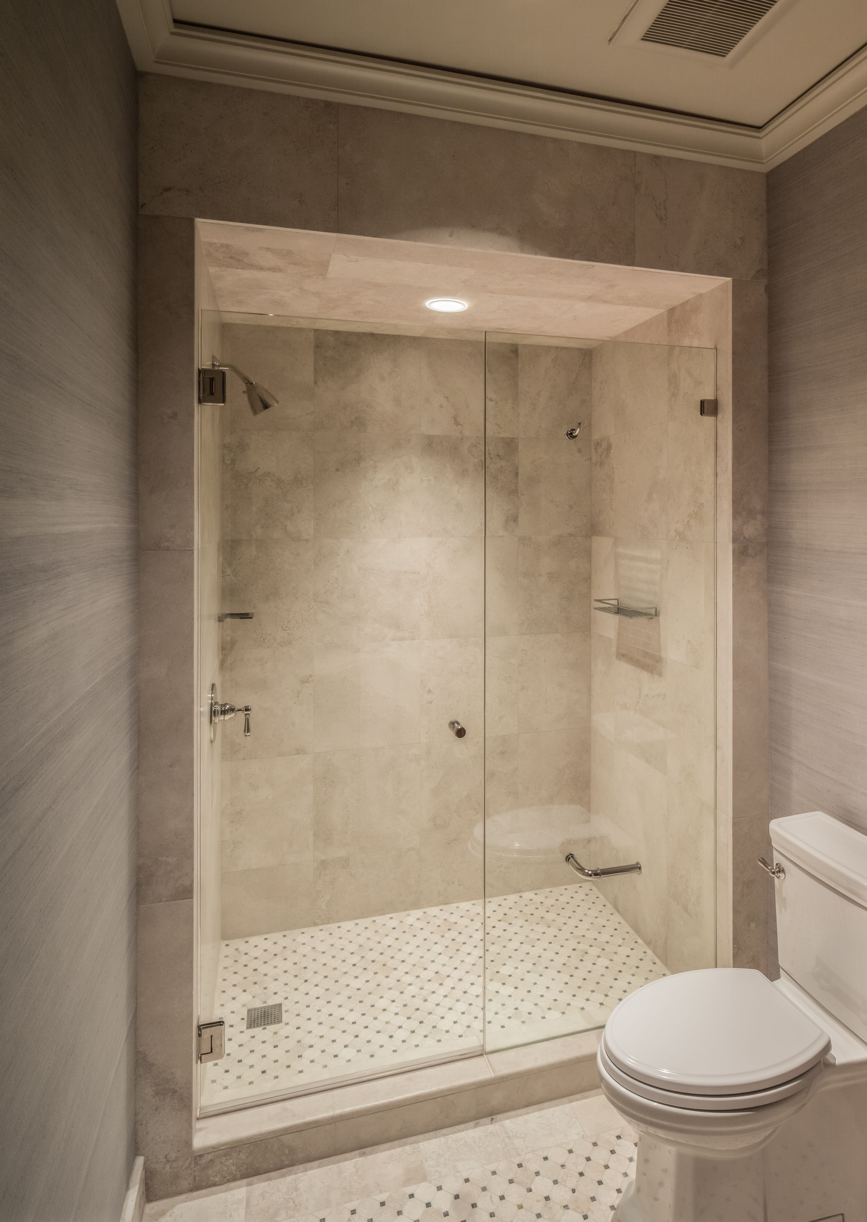 Frameless shower by Dauphin with toilet paper holder installed in ...