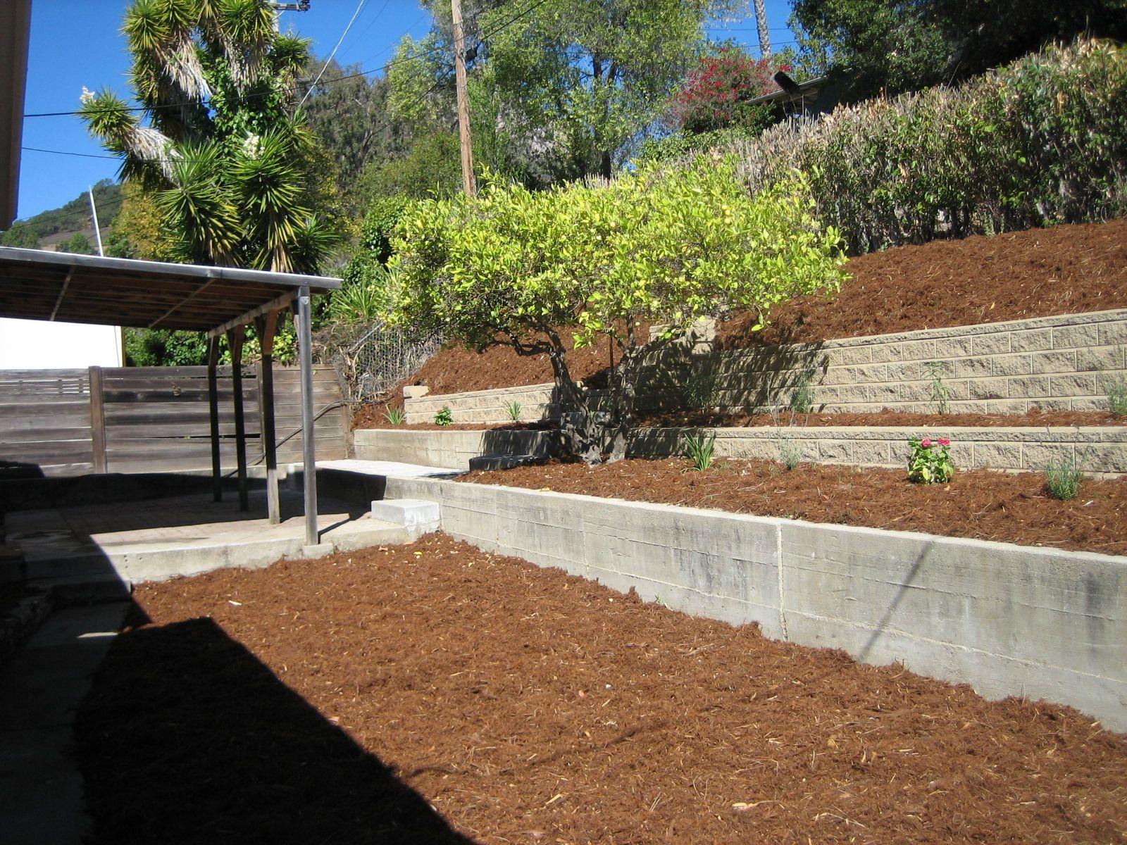 great backyards   Terraced Backyard with attractiveblock ... on Retaining Wall Ideas For Sloped Backyard id=33214