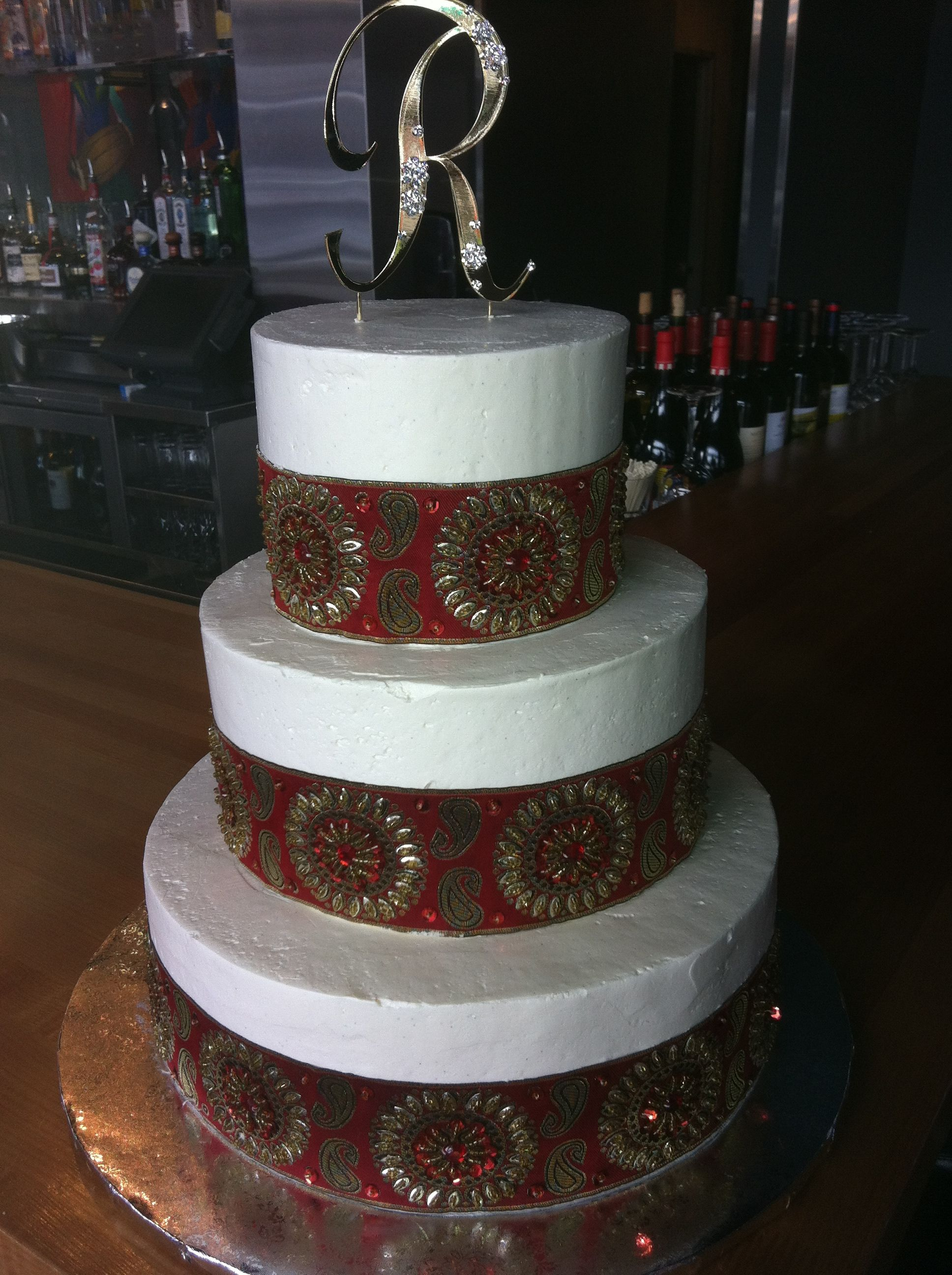 Buttercream wedding cake with sequined ribbon boarder