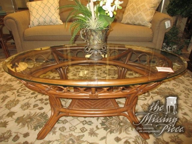 Glass Top Coffee Table On A Medium Toned Rattan Base Ideal Find